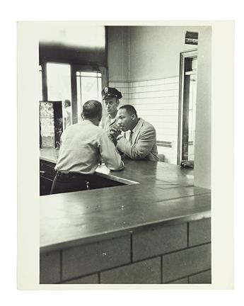 (CIVIL RIGHTS.) PHOTOGRAPHY. Group of 7 gelatin silver prints from the Black Star Agency.