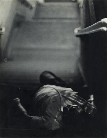 ROY DECARAVA (1919-2009) Man Lying Down, Subway Steps.