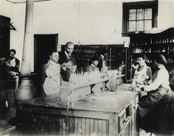 (TUSKEGEE INSTITUTE) George Washington Carver (1864-1943) supervising male and female students at Tuskegee Institute.