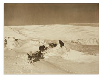 BYRD, RICHARD E. Large Photograph Signed, REByrd, showing him with his dogsled on the ice.