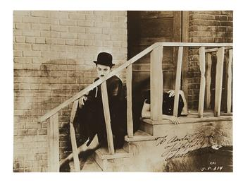 CHAPLIN, CHARLIE. Photograph Signed and Inscribed, To Andie[?] Thomas / Faithfully / Chas Chaplin, film still, showing him in a scene