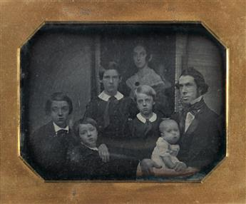 (VICTORIANA) Beautiful half-plate daguerreotype of family members in mourning, in which they are posed with a painting of the deceased.