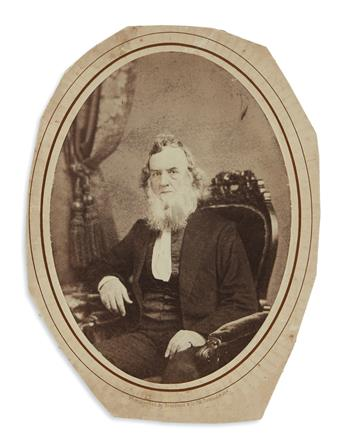 (CIVIL WAR.) Broadbent & Co.; photographers. Salt print photograph of Gideon Welles, with photo of his son Edgar.