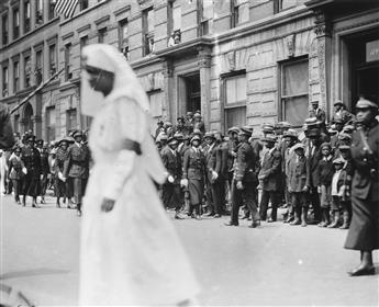 JAMES VAN DER ZEE (1886-1983) Nurse walking on crowded Harlem street.