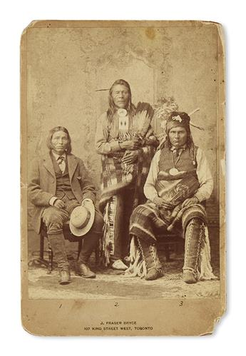 (AMERICAN INDIANS.) Bryce, J. Fraser; photographer. Cabinet card depicting three Cree and Nakoda chiefs in Toronto.
