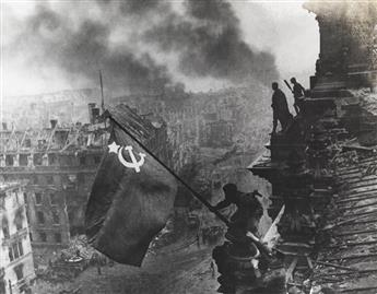 YEVGENY KHALDEI (1917-1997) Raising a flag over the Reichstag, Berlin.