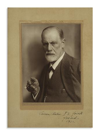 (SCIENTISTS.) FREUD, SIGMUND. Photograph Signed and Inscribed, To his dear H.W. Frink / Freud / 1922, in German,
