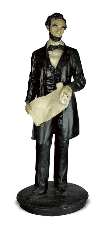 (SCULPTURE.) Full-figure statuette of Lincoln holding the Emancipation Proclamation, after Volk.