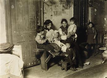 LEWIS W. HINE (1874-1940) Tenement family, Chicago.