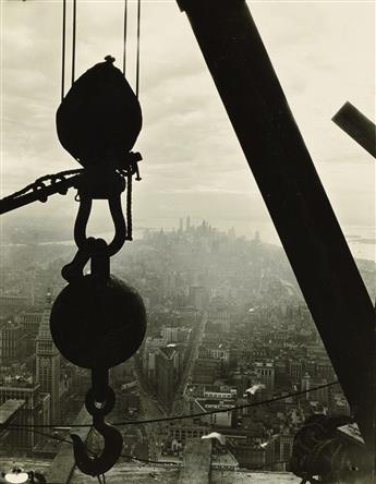 LEWIS W. HINE (1874-1940) Silhouetted crane hook (with lower Manhattan visible from the Empire State Building).