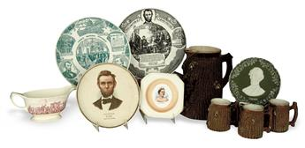 (REALIA.) Group of 12 Lincoln-themed ceramic pitchers, mugs, and plates, and silverware.