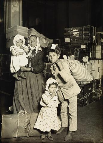 LEWIS W. HINE (1874-1940) Italian family in the baggage room, Ellis Island.