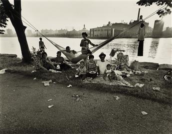 BRUCE DAVIDSON (1933- ) Picnic, East River, N.Y.