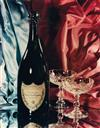 (MOËT ET CHANDON) A pair of opulent still lifes featuring the luxurious Champagne brand, including a bottle of Dom Pérignon, along with