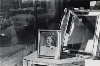 LEE FRIEDLANDER (1934- ) Mickey Rooney in window.
