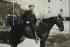 (WASHINGTON, BOOKER T.) Photographic portrait of Washington on horseback,