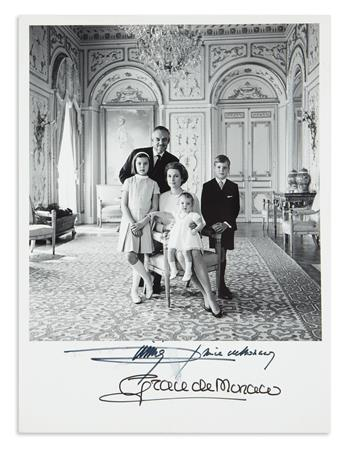 GRACE; PRINCESS OF MONACO. Group Photograph Signed, Grace de Monaco, full-length portrait showing her seated and surrounded by her hu