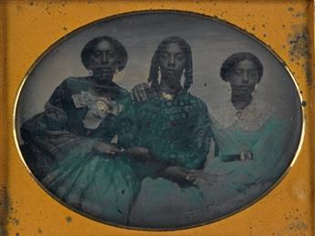 (AFRICAN AMERICAN) Group of 3 cased images, comprising a sixth-plate daguerreotype of a well-dressed woman holding an infant;