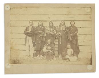 (AMERICAN INDIANS--PHOTOGRAPHS.) Photograph of a white man and 6 Indians.