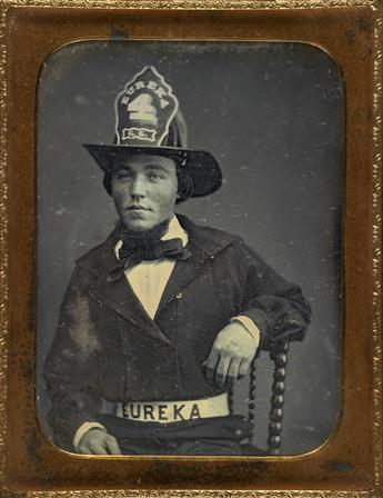 (OCCUPATIONAL) Quarter-plate daguerreotype of a fireman, with EUREKA inscribed on his hat and belt; in