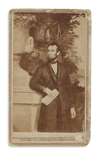 (PHOTOGRAPHY.) A carte-de-visite of Lincoln with the Emancipation Proclamation, said to be presented by him to a White House visitor.