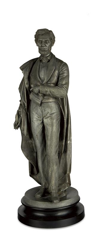 (SCULPTURE.) Metal alloy statuette of Lincoln the Emancipator.