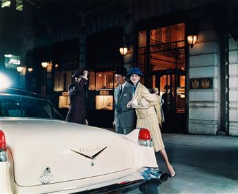 (ADVERTISING) Pair of upscale luxury automobile ads, comprising a well-heeled couple in front of Cartiers