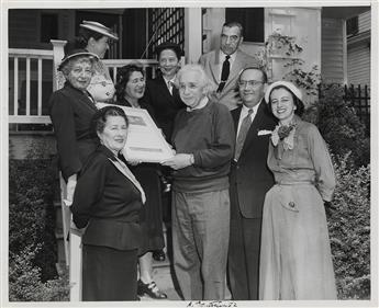 (SCIENTISTS.) EINSTEIN, ALBERT. Photograph Signed, A. Einstein. 52, full-length group portrait showing him standing with Hadassah Nat