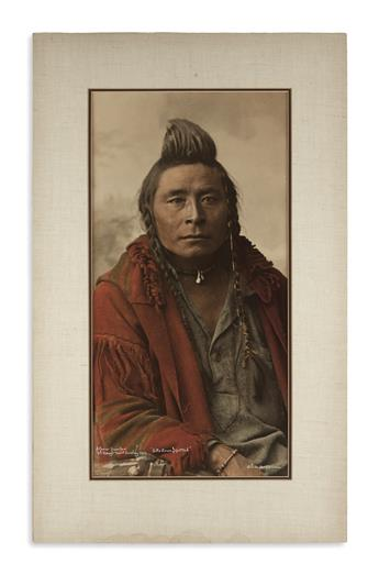 (AMERICAN INDIANS--PHOTOGRAPHS.) Huffman, Laton A.; photographer. A Crow Hunter, Sits Down Spotted.