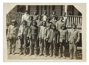 (AMERICAN INDIANS--PHOTOGRAPHS.) Photograph believed to depict Geronimo and other Apache prisoners.